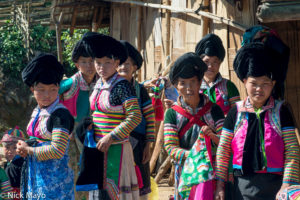 A group of White Hmong women in their traditional clothes and peaked turbans in the village of Chen Jia Jie in Burma's Shan State.